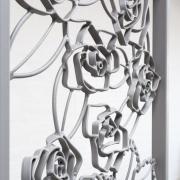 Figuratief-Sierhek-werk-met-bloem-motief-Goeters